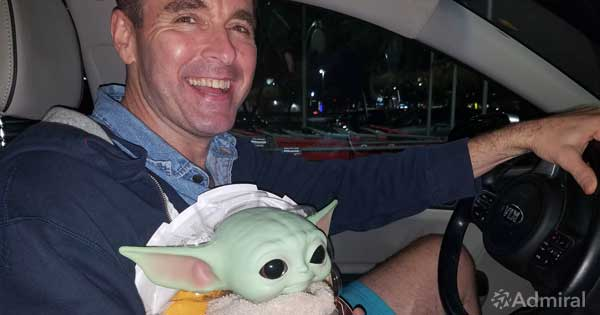 Admiral CEO Dan Rua with Baby-Yoda for Toys for Tots
